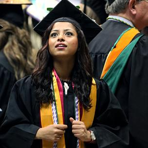 Graduate Waving to Family in Stands