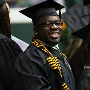 Graduate Smiling While Waiting to Receive Diploma