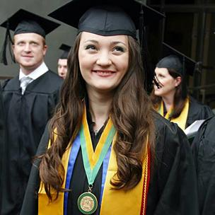 Graduate Smiling Outside of Union after Graduation