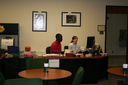 Desk workers greet visitors to the Writing Center