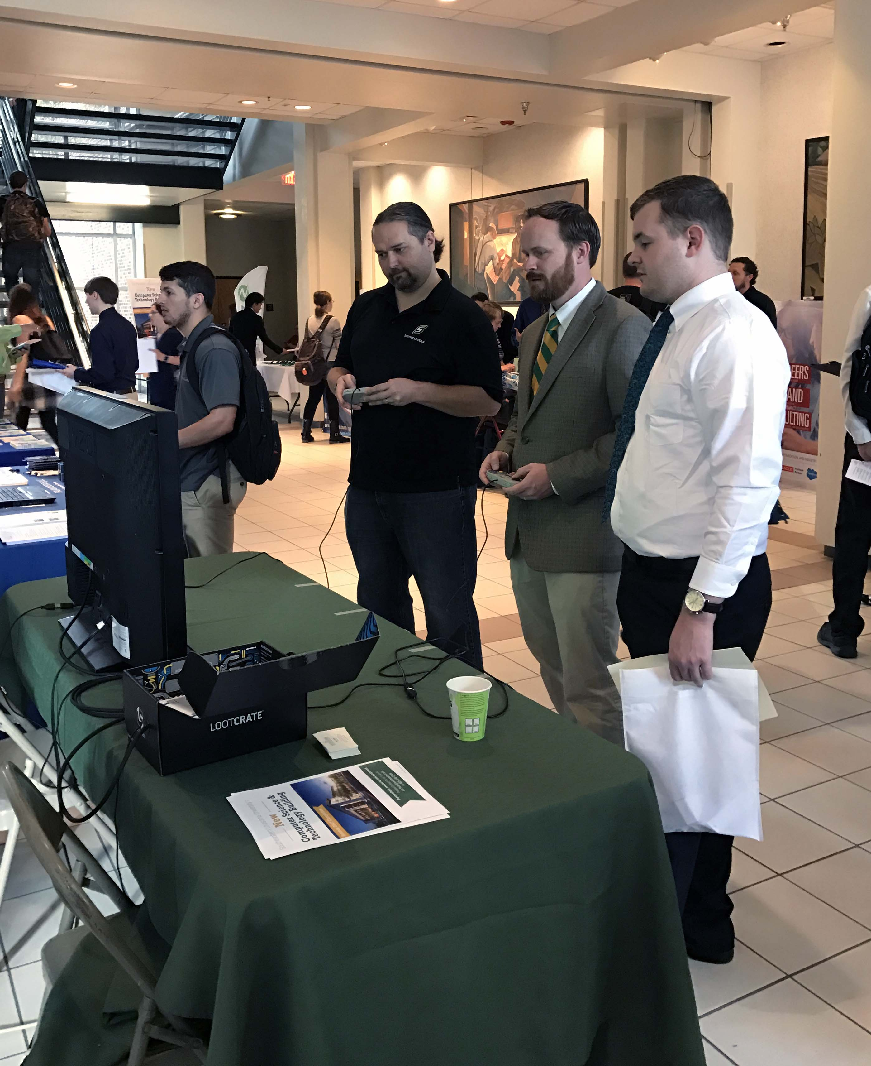 Students intereacting with employers at Tech-Connect