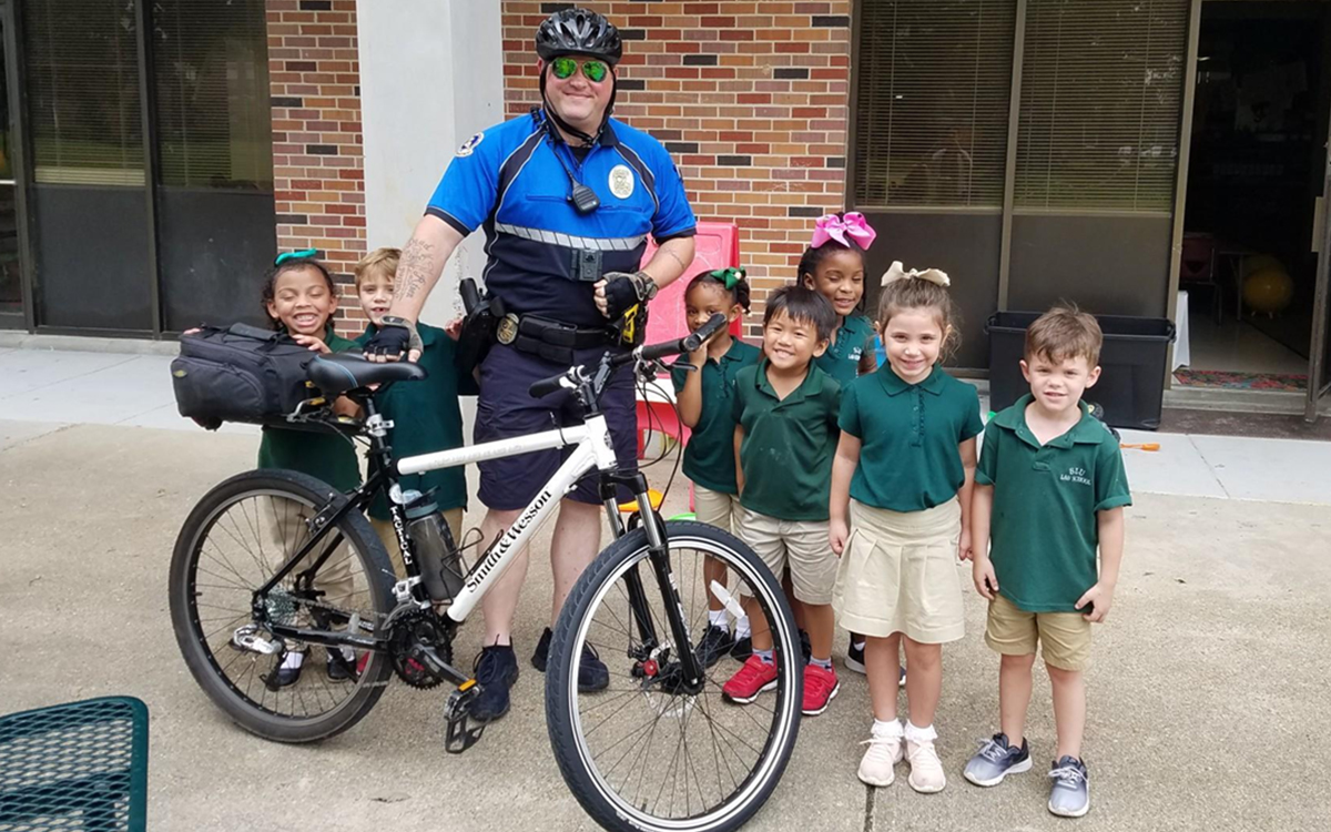 Police Officer with Children from Lab School