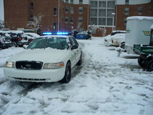 Snow on police car
