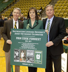 President John L. Crain, Pam Cook Forrest, and Athletic Director Bart Bellairs