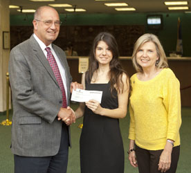 First Guaranty Bank makes scholarship donation
