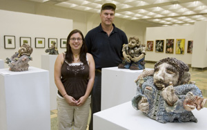 Dennis Sipiorski, head of the Department of Visual Arts, and Jamie Alonzo at her art showing