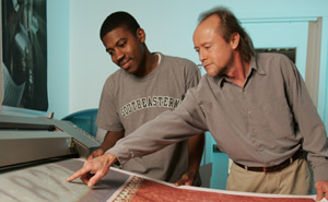 Professor Gary Keown with student Michael Kyles viewing a print on the large-format printer