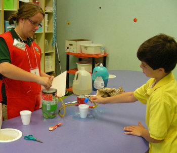 Rebecca Harris works with Ethan Keller on a science experiment at Super Science after Hours.