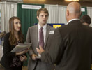 A representative of the FBI speaks with students at Career Fair