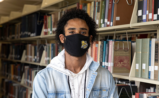 Student in Mask in Library